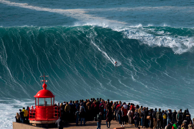 Brazilian surfer Rodrigo Koxa rides a wave during a free surfing session in Nazare, on November 20, 2019, waves reached between 15 and 20mt high. Nazare host one the two big waves surfing contest in the world, with waves reaching up to 30 meters at winter time. (Photo by Olivier Morin/AFP Photo)