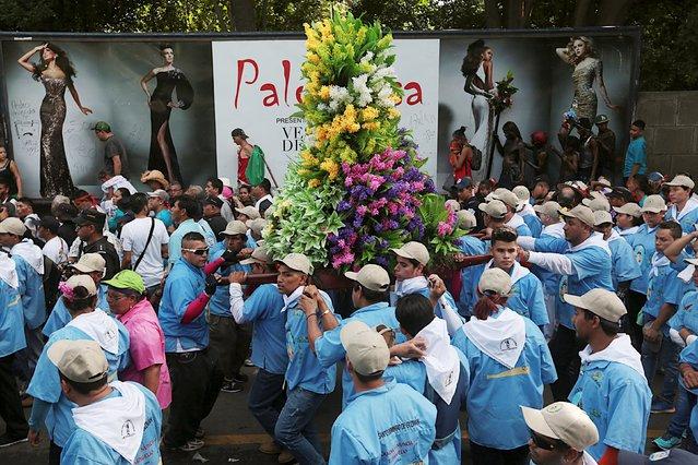 People take part in celebrations honoring the patron saint of Managua, Santo Domingo de Guzman, in Managua, Nicaragua, August 1, 2015. (Photo by Oswaldo Rivas/Reuters)