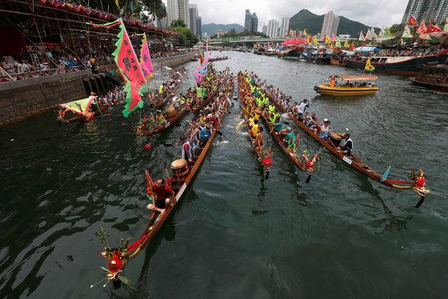 Dragon boats get together during a ceremony in between races during Tung Ng or Dragon Boat Festival at Aberdeen fishing port in Hong Kong June 9, 2016. (Photo by Bobby Yip/Reuters)