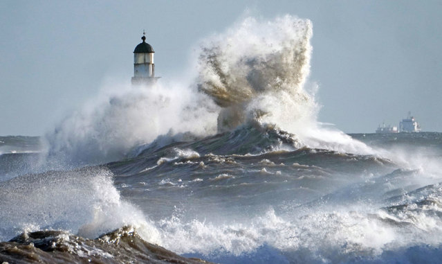 Waves crash against the pier wall on December 9, 2019 at Seaham Lighthouse on the County Durham coast as weather warnings remain in owing to strong winds from Storm Atiyah. (Photo by Owen Humphreys/PA Images via Getty Images)