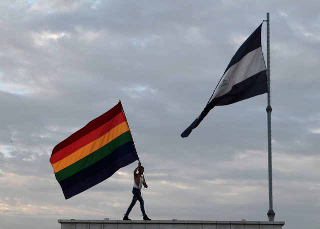 A participant holds up a rainbow flag during a gay pride parade in Managua, Nicaragua June 28, 2016. (Photo by Oswaldo Rivas/Reuters)