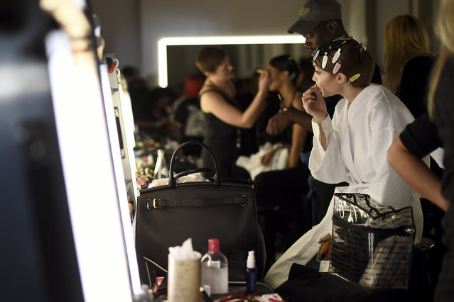 "Jelena Noura ""Gigi"" Hadid prepares backstage at the Tom Ford show at Milk Studios during NYFW Fall/Winter 2020 on Friday, February 7, 2020, in Los Angeles. (Photo by Jordan Strauss/Invision/AP Photo)"