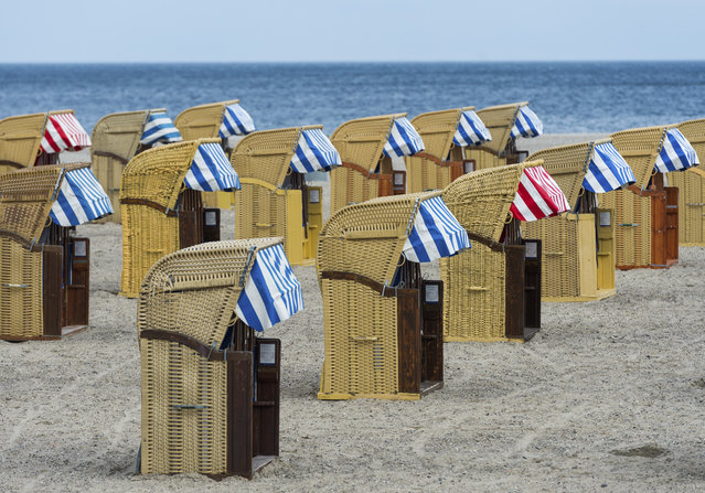 Empty beach chairs are placed on a beach near the Baltic Sea town of Travemuende, Germany, Friday, April 14, 2017. Weather forecasts predict changeable weather. (Photo by Christophe Gateau/DPA via AP Photo)