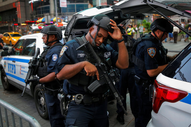 Members of the New York Police Department's Counterterrorism Bureau monitor Times Square as security increases leading up to the July 4 holiday weekend in Manhattan, New York, U.S., July 1, 2016. (Photo by Andrew Kelly/Reuters)