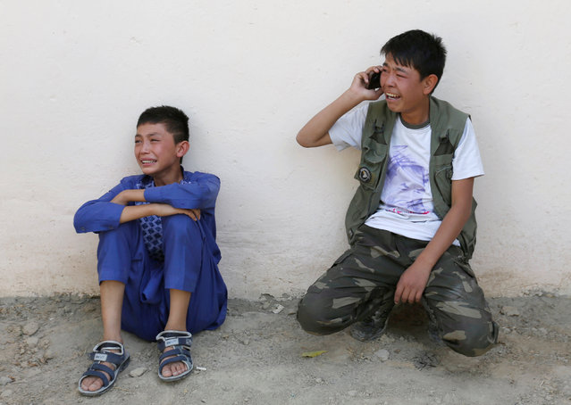 Afghan boys mourn at the site of a suicide attack followed by a clash between Afghan forces and insurgents after an attack on a Shi'ite Muslim mosque in Kabul, Afghanistan on Friday, August 25, 2017. (Photo by Mohammad Ismail/Reuters)