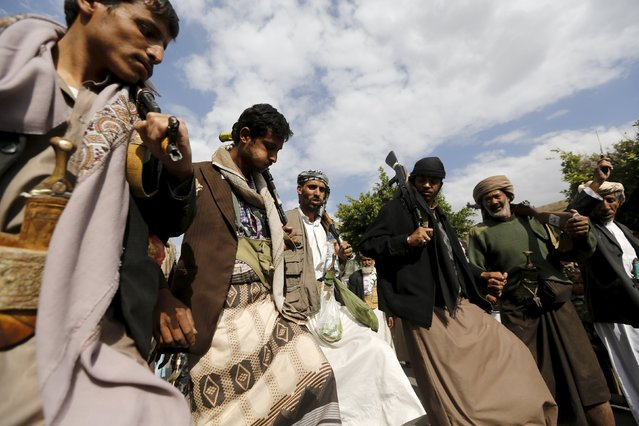 Houthi followers perform the traditional Baraa dance ahead of a demonstration against the Saudi-led air strikes in Yemen's capital Sanaa August 24, 2015. (Photo by Khaled Abdullah/Reuters)