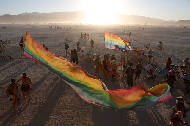 The sun sets on the playa as approximately 70,000 people from all over the world gathered for the annual Burning Man arts and music festival in the Black Rock Desert of Nevada, U.S. August 28, 2017. (Photo by Jim Urquhart/Reuters)