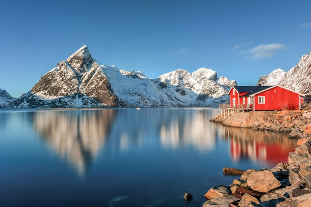 """""""The Lofoten Islands along the Arctic Circle in Northern Norway are a magical place filled with snow capped mountains and crystal clear lakes as well as idyllic red fishermen's huts"""", wrote Felix Lipov, 35, of Brooklyn. (Photo by Felix Lipov)"""