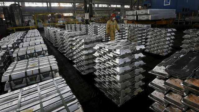 An employee walks along aluminium ingots at the foundry shop of the Rusal Sayanogorsk aluminium smelter outside the town of Sayanogorsk, Russia, September 3, 2015. (Photo by Ilya Naymushin/Reuters)