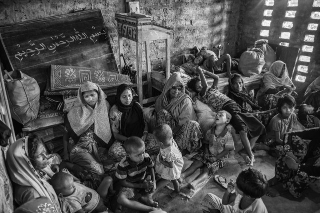 Rohingya refugees rest in an Islamic school or madrassa  after arriving by boat on the Bangladesh side of the Naf River at Shah Porir Dwip after fleeing their villages in Myanmar, on September 22, 2017 in Cox's Bazar, Bangladesh. (Photo by Kevin Frayer/Getty Images)