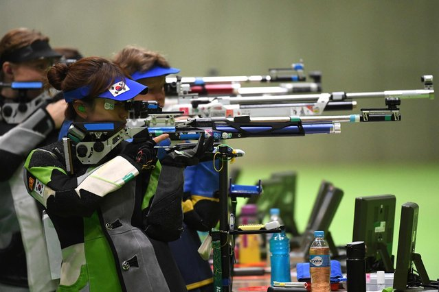South Korea's Kim Eunhye competes in the women's 10m air rifle shooting qualifications at the Rio 2016 Olympic Games at the Olympic Shooting Centre in Rio de Janeiro on August 6, 2016. (Photo by Pascal Guyot/AFP Photo)