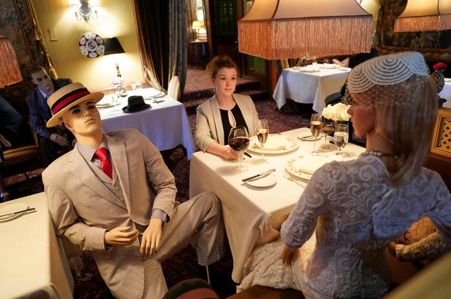 Executive Assistant Jessie Dawson sits among mannequins occupying some tables so diners will not feel isolated by coronavirus social distancing measures when The Inn at Little Washington, a Michelin three-star restaurant, reopens shortly in Washington, Virginia, May 20, 2020. (Photo by Kevin Lamarque/Reuters)