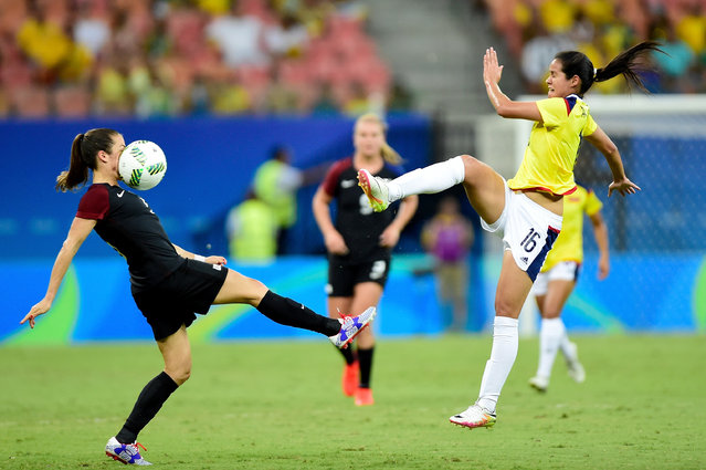 Kelley O'Hara #5 of the United States is hit in the face with the ball against Lady Andrade #16 of Colombia in the first half of the Women's Football First Round Group G match on Day 4 of the Rio 2016 Olympic Games at Amazonia Arena on August 9, 2016 in Rio de Janeiro, Brazil. (Photo by Bruno Zanardo/Getty Images)