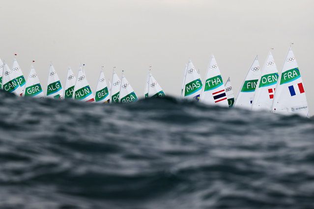 The Women's Laser Radial class waits to compete on Day 7 of the Rio 2016 Olympic Games at Marina da Gloria on August 12, 2016 in Rio de Janeiro, Brazil. (Photo by Clive Mason/Getty Images)