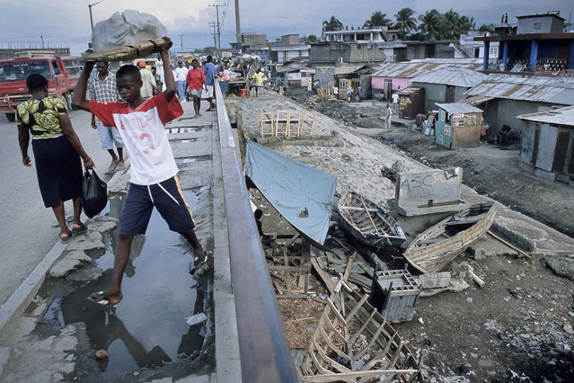 Cap-Haitien, Haiti. On the bridge spanning the Faussette slums in October 2003. (Photo by Jean-Claude Coutausse)
