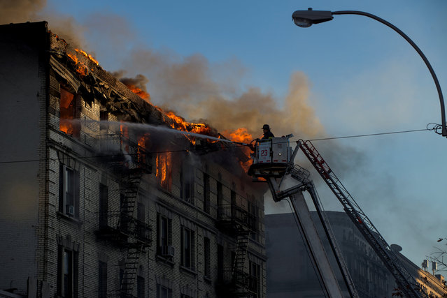 A fire is seen in Manhattan, New York, U.S. November 17, 2017, in photo obtained by Reuters. (Photo by Steven Gabriel Photography via Reuters)