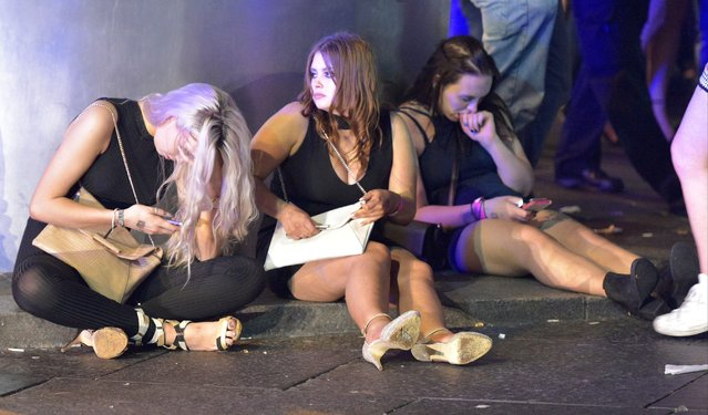 Mayhem hits the streets of Newcastle, UK as clubbers out on the Toon have a little too much to drink as they enjoy the Bank Holiday on August 29, 2016. Photographs take last night show scantily-clad women passed out on the pavement, while boozed-up men were caught arguing with police. (Photo by XposurePhotos.com)