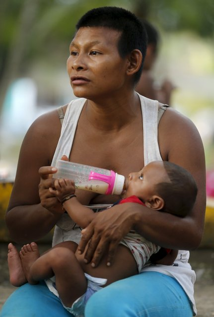 A Colombian Nukak Maku Indian woman feeds her baby on a street in San Jose del Guaviare of Guaviare province September 4, 2015. (Photo by John Vizcaino/Reuters)