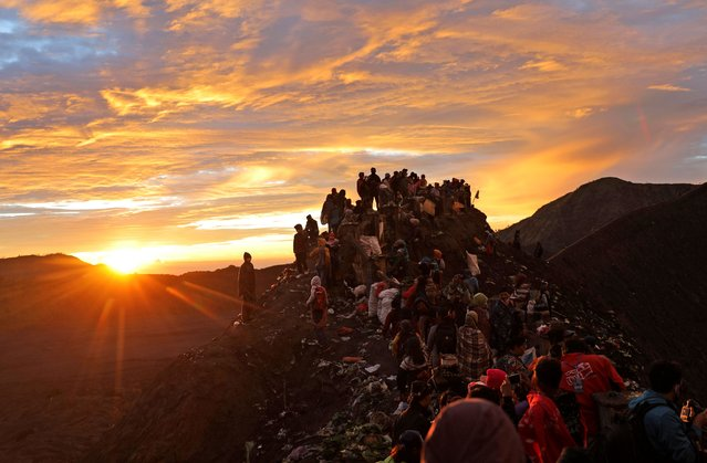 Hindu devotees and visitors make their way to the top of of Mount Bromo at dawn during Yadnya Kasada festival in Probolinggo, East Java, Indonesia, Tuesday, July 7, 2020. Every year people gathered for the annual festival where offerings of rice, fruit, vegetables, livestock or money are made to Hindu gods at the active volcano to ask for blessings and assure a bountiful harvest. (Photo by Trisnadi/AP Photo)
