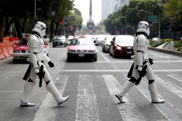 Two people dressed as Star Wars Storm Troopers cross Reforma Avenue in Mexico City, Mexico, August 26, 2017. (Photo by Edgard Garrido/Reuters)