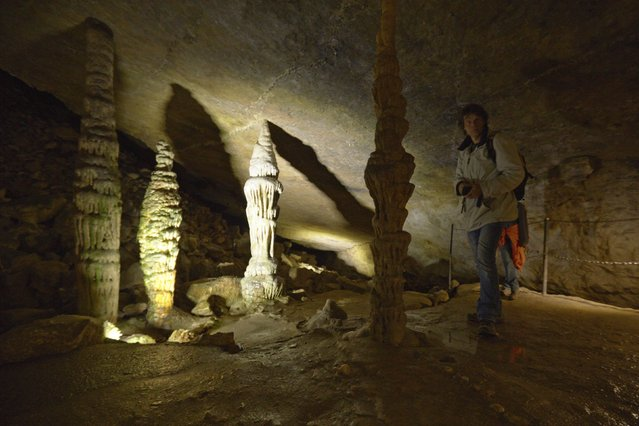 Stalagmites grow in cave on the border with France (behind) and Switzerland (front) in Reclere April 24, 2014. (Photo by Denis Balibouse/Reuters)