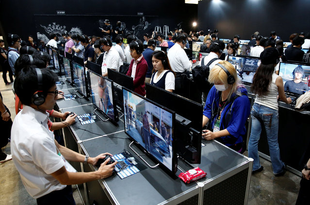 "People play the video game ""Final Fantasy XV"" at Tokyo Game Show 2016 in Chiba, east of Tokyo, Japan, September 15, 2016. (Photo by Kim Kyung-Hoon/Reuters)"