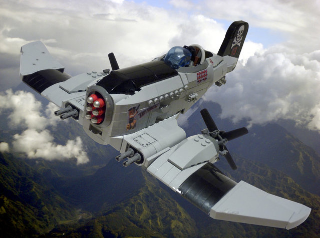 """""""P-23 Skywolf. Sky pirate Grant """"Mad Dog"""" Hendricks piloting his P-23 Skywolf. A member of the feared Crossbones Gang they terrorised air shipping, stealing cargo and holding passengers for ransom until Hendricks was finally shot down by flying ace Betty Redwing with a lucky shot to the nose!. (Jon Hall)"""
