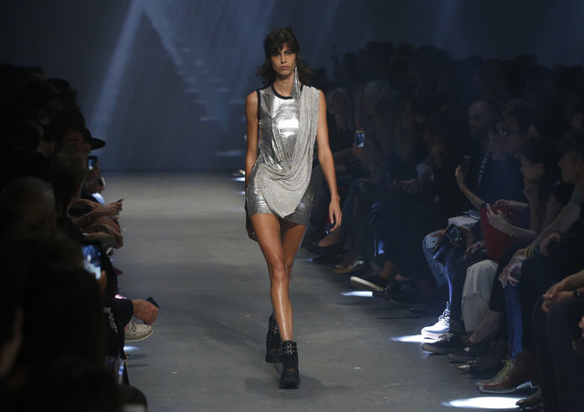 A model wears a creation by designer Donatella Versace for her label Versus during her Spring/Summer 2017 runway show at London Fashion Week in London, Saturday, September 17, 2016. (Photo by Alastair Grant/AP Photo)