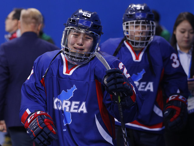 Korea's Lee Jing-yu cries after her team lost to Japan in Preliminary Round Ice Hockey action February 14, 2018. (Photo by Brian Snyder/Reuters)