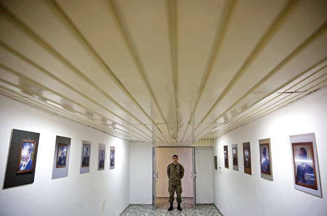 A member of the Armed Forces of Bosnia and Herzegovina stands near Josip Broz Tito's portraits in Tito's underground secret bunker (ARK) in Konjic, October 16, 2014. (Photo by Dado Ruvic/Reuters)