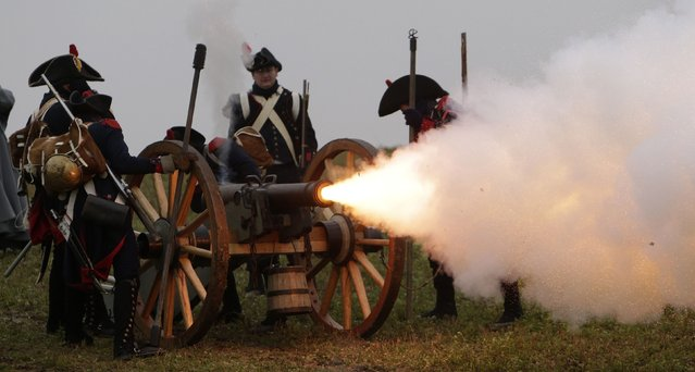 History enthusiasts, dressed as soldiers, fire a fake cannon during the re-enactment of Napoleon's famous battle of Austerlitz near the southern Moravian town of Slavkov u Brna November 29, 2014. (Photo by David W. Cerny/Reuters)