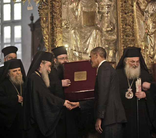 President Barack Obama is presented a gift by Greek Orthodox Patriarch Theophilos III, left,  Friday, March 22, 2013, at the Church of the Nativity during his visit to the West Bank city of Bethlehem. (Photo by Pablo Martinez Monsivais/AP Photo)