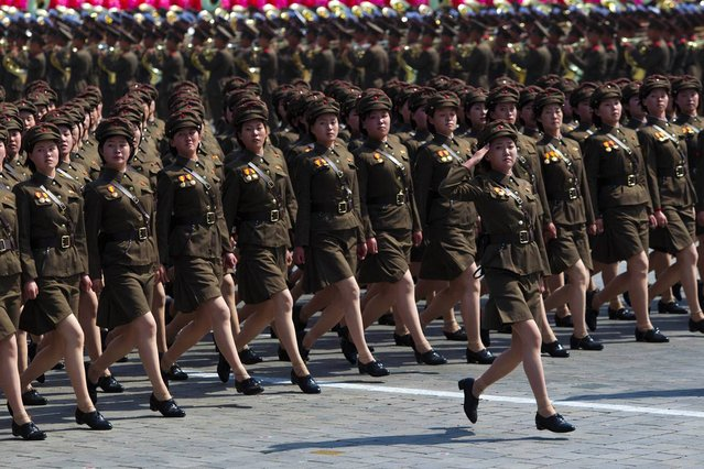 North Korean soldiers march during a mass military parade in Pyongyang's Kim Il Sung Square, on Sunday, April 15, 2012. (Photo by David Guttenfelder/AP Photo)
