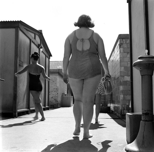"""""""Bulging at beach in 1949, 197-pound Dorothy (Bradley) self-consciously leaves locker room for swim. She covered up embarrassment by being jolly and gregarious"""". (Photo by Martha Holmes/Time & Life Pictures)"""