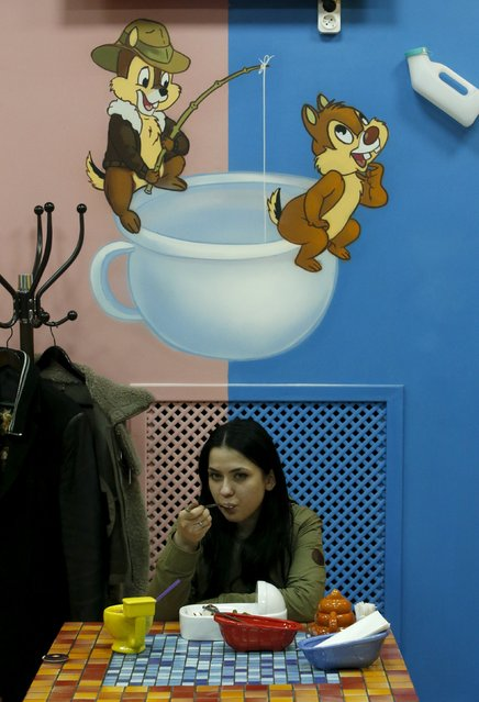 A woman eats at Crazy Toilet Cafe in central Moscow, Russia October 30, 2015. (Photo by Sergei Karpukhin/Reuters)
