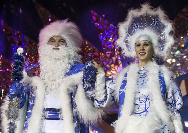 "People dressed as Father Frost, the equivalent of Santa Claus, and Snow Maiden take part in the contest ""Yolka-fest-2014"" (Fir-festival-2014) in Minsk December 12, 2014. (Photo by Vasily Fedosenko/Reuters)"