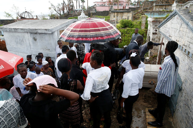 People react during the funeral of a woman who died during Hurricane Matthew in Jeremie, Haiti, October 17, 2016. (Photo by Carlos Garcia Rawlins/Reuters)