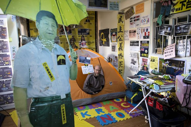 An Occupy-themed guesthouse run by British freelance writer Stephen Thompson, 50, is pictured as he poses in his tent in Hong Kong December 30, 2014. (Photo by Tyrone Siu/Reuters)