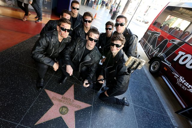 In this image distributed on Tuesday, November 10, 2015 Terminators pose for selfies with their favorite star on the Hollywood Walk of Fame in Hollywood, Calif. in celebration of the Blu-ray and Digital HD debut of the global blockbuster Terminator Genisys. (Photo by Casey Rodgers/Invision for Paramount Home Entertainment/AP Images)