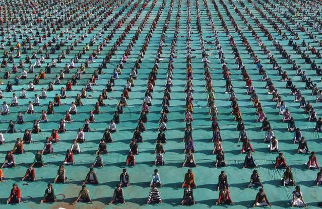 Schoolchildren attend a yoga session at a camp in the western Indian city of Ahmedabad January 6, 2015. (Photo by Amit Dave/Reuters)