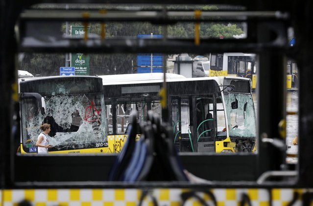 Damaged buses are seen in Taksim where police and anti-government protesters clashed in central Istanbul June 2, 2013. (Photo by Murad Sezer/Reuters)