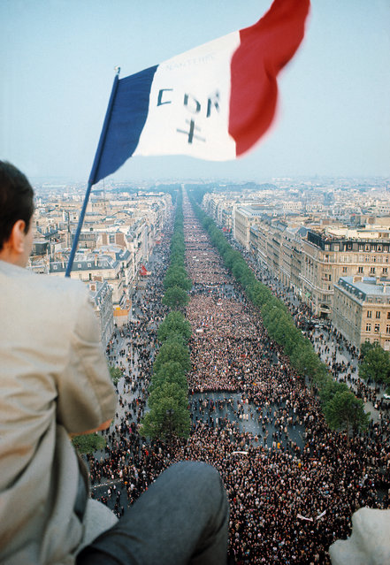"""More than a half-million people march up the Avenue des Champs-Elysées from the Place de la Concorde to show support for President Charles De Gaulle after the President gave a radio speech to the nation in which he announced the dissolution of the National Assembly, postponement of the Referendum (to June 16), a change in the government under Prime Minister Pompidou, and a call to civic action """"everywhere and immediately to help the government and prefects"""" facing students' and workers' unrest, Place de l'Etoile, Paris, France, May 30, 1968. (Photo by Gökşin Sipahioğlu/SIPA Press)"""