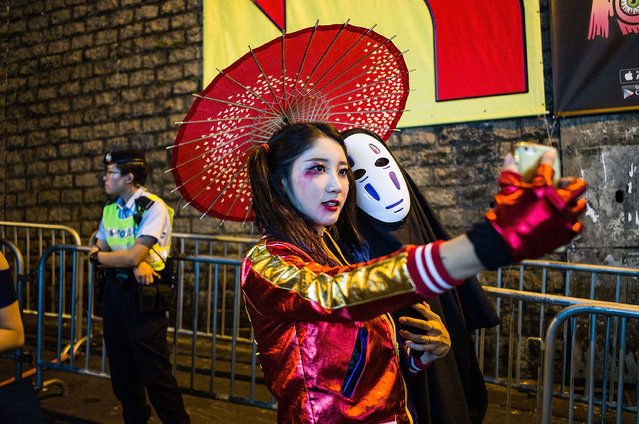 People take part in a Halloween street party at Lan Kwai Fong on October 31, 2016 in Hong Kong. Halloween, a contraction of All Hallows' Evening, falls on the day before All Saints' Day on November 1, a holiday when Christians remember their deceased loved ones. (Photo by Lam Yik Fei/Getty Images)