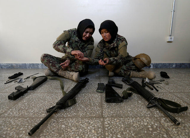 Female soldiers Karima Mohamadi, 21 (L), and Tamana, 19 (R), from the Afghan National Army (ANA) clean their weapons at the Kabul Military Training Centre (KMTC) in Kabul, Afghanistan October 26, 2016. (Photo by Mohammad Ismail/Reuters)