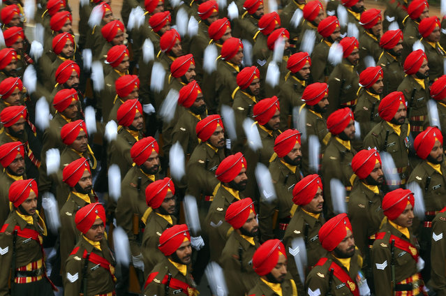 Indian soldiers march down Rajpath, a ceremonial boulevard, during full dress rehearsal ahead of Republic Day parade in New Delhi, India, Friday, January 23, 2015. (Photo by Saurabh Das/AP Photo)