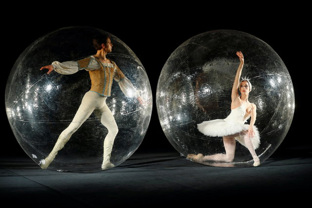 "Stuttgart Ballet company dancers Elisa Badenes and Friedemann Vogel take part in the performance ""Social Distance Stacks"" of conceptual artist Florian Mehnert at the John Cranko School in Stuttgart, Germany, February 26, 2021. (Photo by Ralph Orlowski/Reuters)"