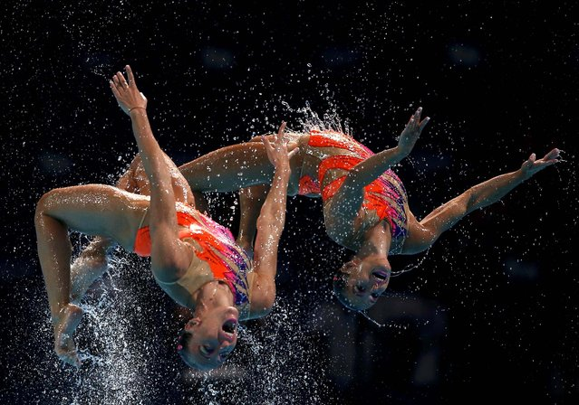 Members of Italy''s synchronized swimming team perform in the team technical final during the World Swimming Championships on 22 July 2013. (Photo by Albert Gea/Associated Press)