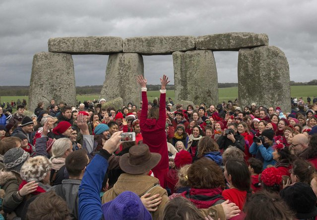 Revellers celebrate the winter solstice at Stonehenge on Salisbury Plain in southern England December 22, 2015. Stonehenge is a celebrated venue of festivities during the winter solstice – the shortest day of the year in the northern hemisphere – and it attracts thousands of revellers, spiritualists and tourists. Druids, a pagan religious order dating back to Celtic Britain, believe Stonehenge was a centre of spiritualism more than 2,000 years ago. (Photo by Kieran Doherty/Reuters)