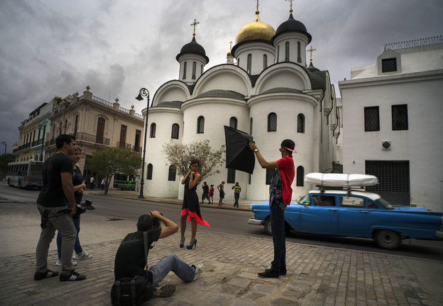 In this December 3, 2015 photo, Gladys Barroso Quintana, 15, who lives in Cuba, poses for photographers outside the Russian Orthodox Church in Havana, Cuba. (Photo by Ramon Espinosa/AP Photo)