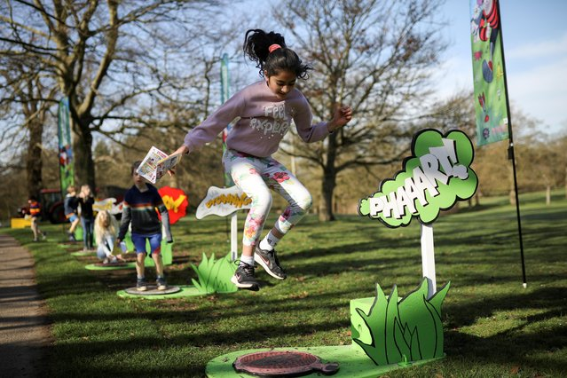 Children play at an Easter festival inspired by Beano comics, at the Royal Botanic Gardens, Kew in London, Britain, March 30, 2021. (Photo by Tom Nicholson/Reuters)